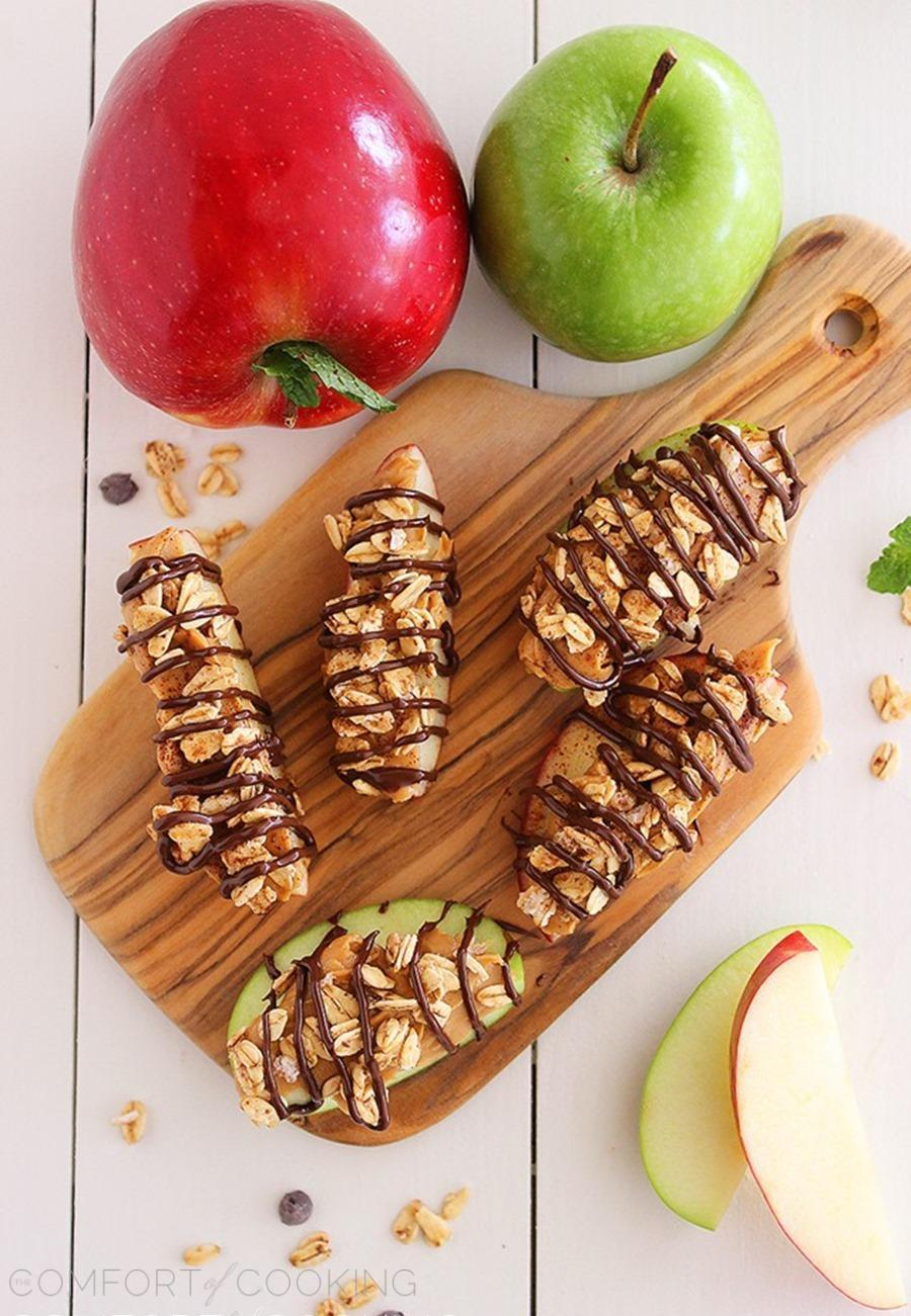 Chocolate-Peanut Butter Granola Apple Bites – Snack on these super easy, delicious and nutritious apple granola bites with a chocolate drizzle!   thecomfortofcooking.com