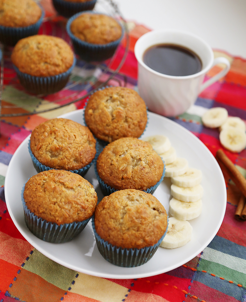 Toasted Coconut Banana Muffins - Super moist, fluffy banana muffins. These make a mouthwatering treat that pairs perfectly with your morning coffee! Thecomfortofcooking.com