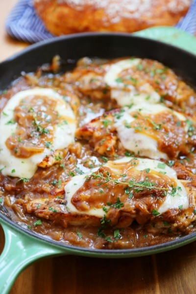 Skillet French Onion Chicken - Saucy, melt-in-your-mouth French onion chicken smothered in caramelized onion gravy, topped with melted cheese. Thecomfortofcooking.com